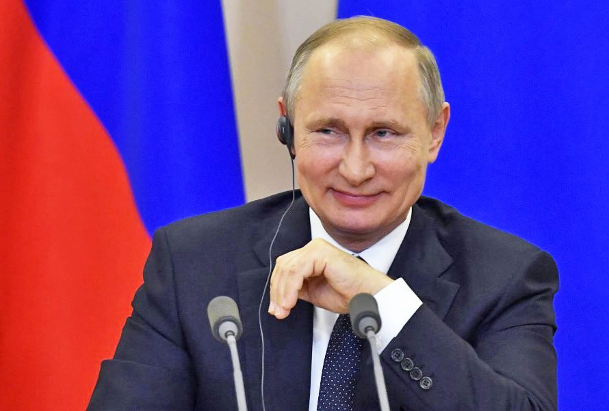 Russian President Vladimir Putin listens to a question at a joint news conference with Italian Prime Minister Paolo Gentiloni at the Bocharov Ruchei state residence in the Russian Black Sea resort of Sochi on Wednesday. Putin has dismissed the ongoing scandal around President Trump sharing classified intelligence with Russian officials as