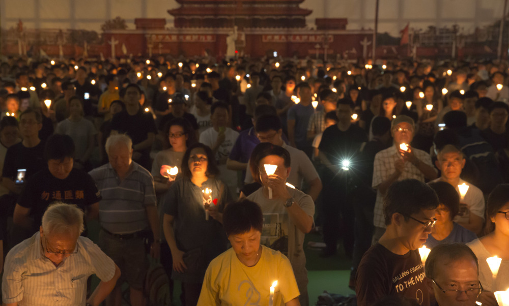 Tens of thousands of people attend an annual candlelight vigil in Hong Kong's Victoria Park on Sunday, as Hong Kong remembers victims of the Chinese government's military crackdown on protesters in Beijing's Tiananmen Square.