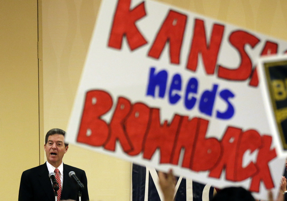 In 2014, Kansas Gov. Sam Brownback was riding a wave of popularity as the state's conservative voters gave him a mandate to embark on an unprecedented tax-cutting plan.