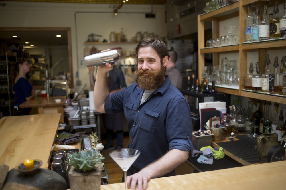 Timm Bielec, the bar manager at Vinland, makes a Pine Gimlet on Saturday.