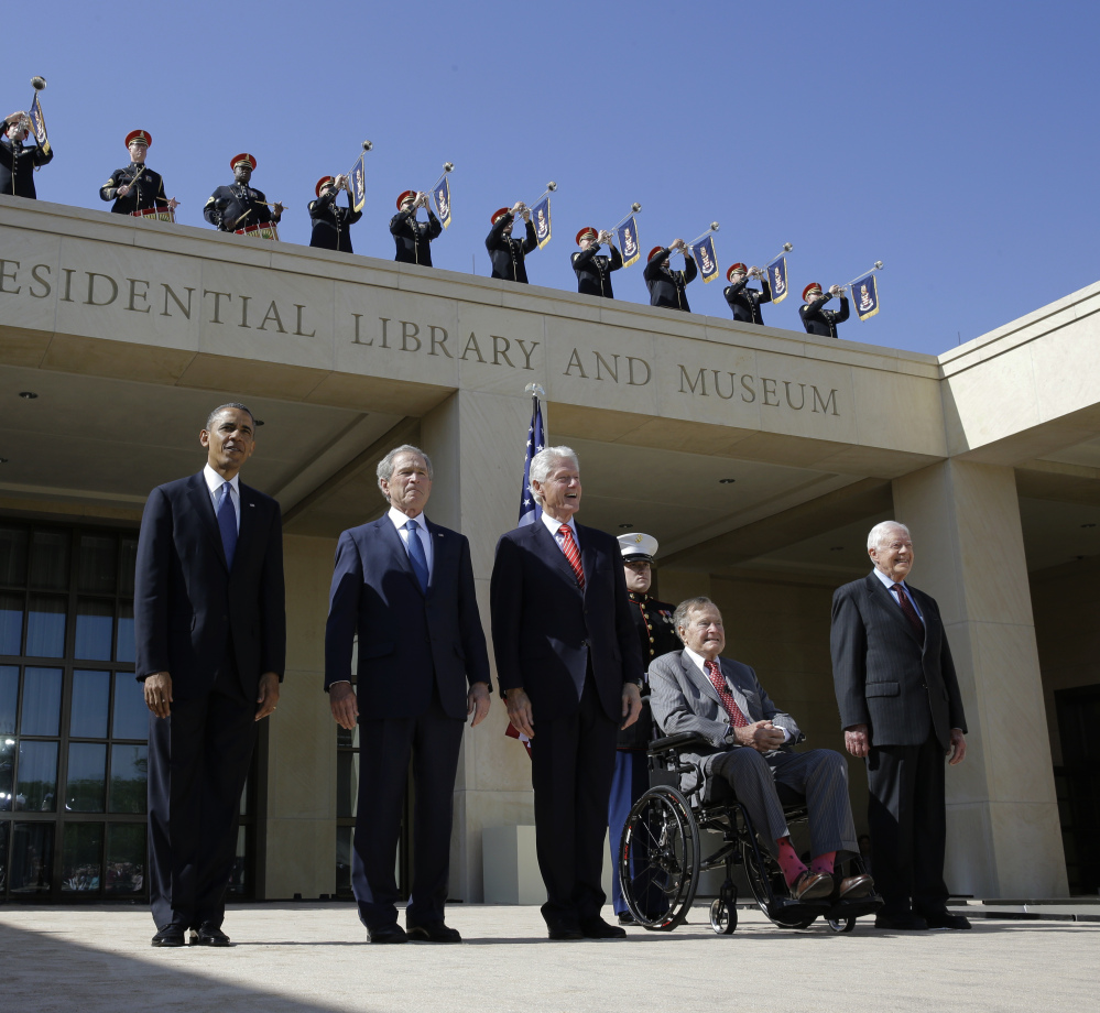 President Barack Obama and former presidents George W. Bush, Bill Clinton, George H.W. Bush and Jimmy Carter arrive for the 2013 dedication of the George W. Bush Presidential Center. Presidential libraries cost U.S. taxpayers $66 million a year.