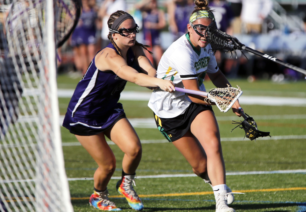 Morgan Pike, right, is one of numerous scoring threats for Massabesic, which faces Messalonskee in the Class A girls' lacrosse state final Saturday at Fitzpatrick Stadium. Messalonskee rallied for a 7-6 win in last year's matchup.