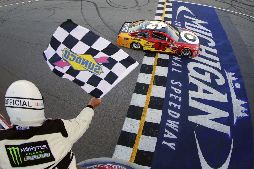 Kyle Larson took control of the lead on a restart with five laps left to earn his second NASCAR Cup Series win of the season, holding off Chase Elliott on Sunday at Michigan International Raceway in Brooklyn, Michigan.