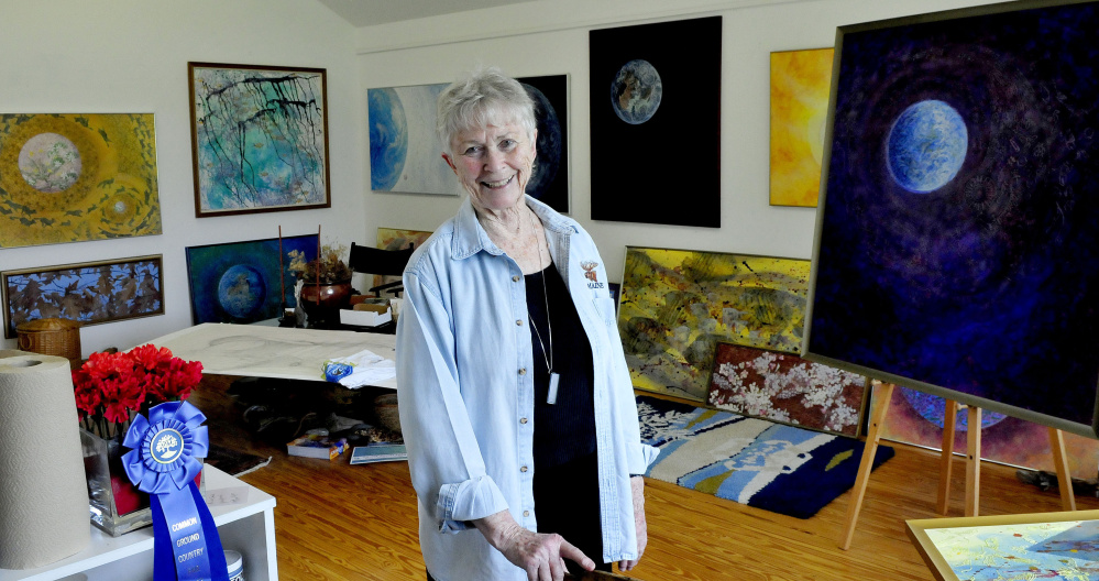 Winslow-based artist Jean Ann Pollard on Tuesday inside her studio, surrounded by artwork related to other pieces in the national Citizens' Climate Lobby project in Washington, D.C.