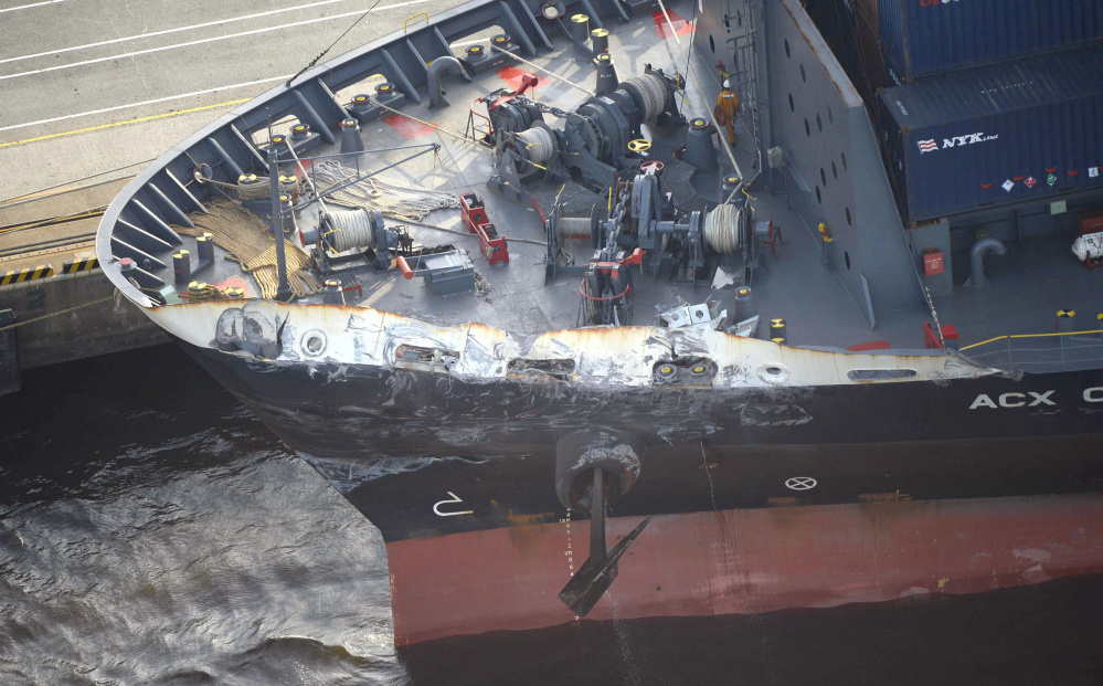 The container ship ACX Crystal's left bow is dented and scraped after colliding with the USS Fitzgerald in the waters off Japan on Saturday. Seven U.S. Navy sailors were killed when the ship collided with their destroyer and flooded compartments includin