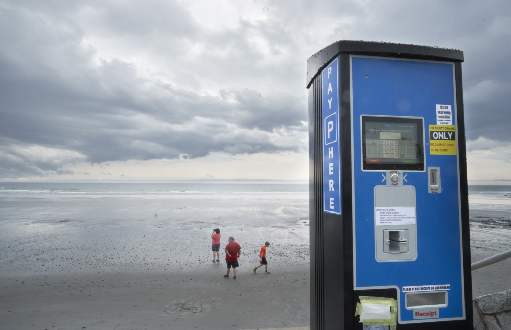 New parking meters along Long Sands Beach in York are malfunctioning, costing the town thousands of dollars in parking revenue. In at least one instance, a machine failed to release a user's credit card, necessitating a pair of pliers to retrieve it.