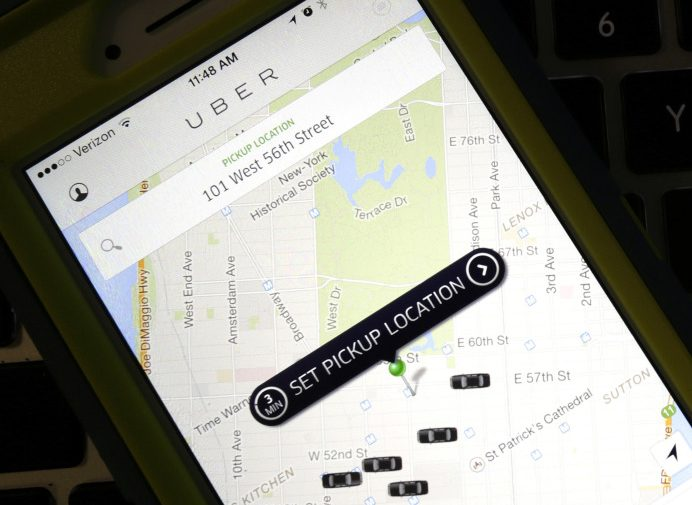 A smartphone displays Uber car availability in New York. Uber is catching up to its rival Lyft by enabling riders to tip its U.S. drivers with a tap on its ride-hailing app.