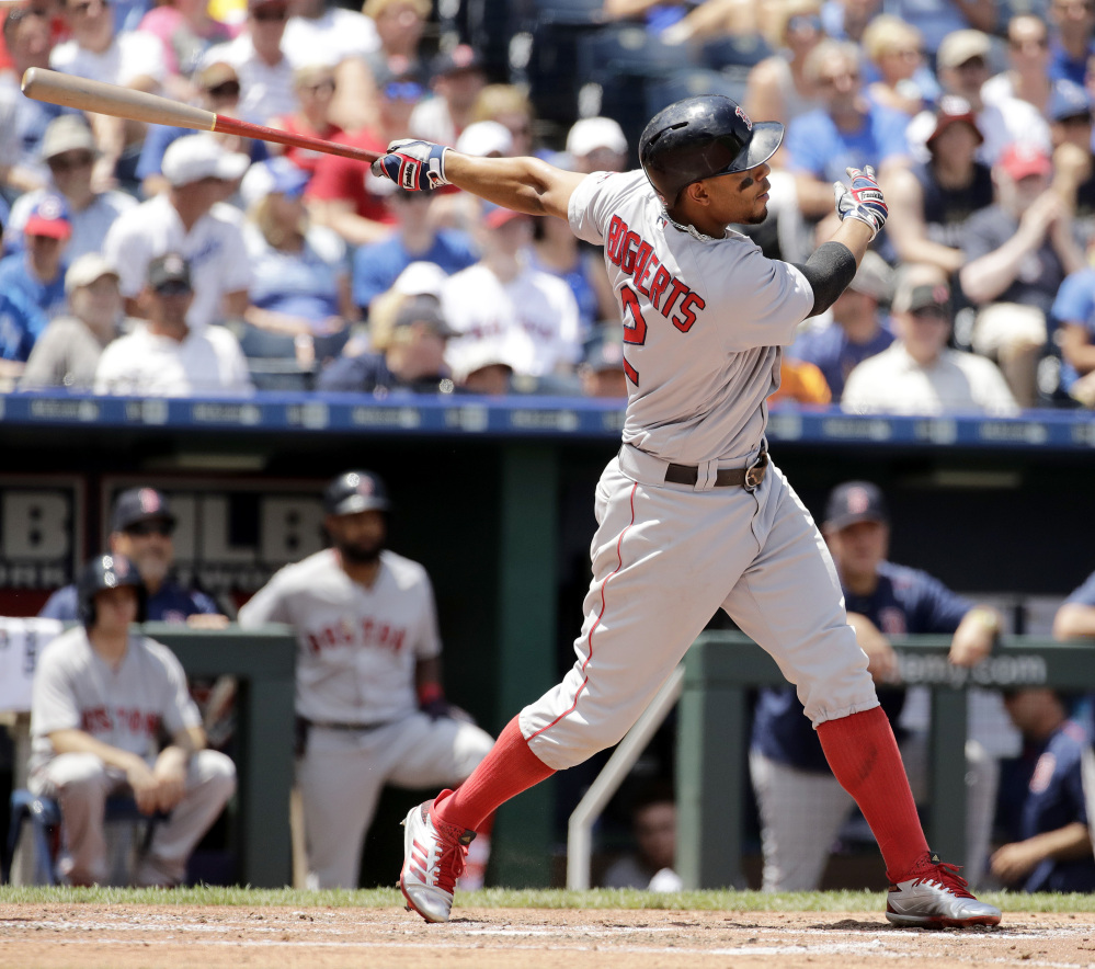 Xander Bogaerts hits a solo home run in the fourth inning. It was the second of back-to-back home runs for the Red Sox, following a blast by Andrew Benintendi.