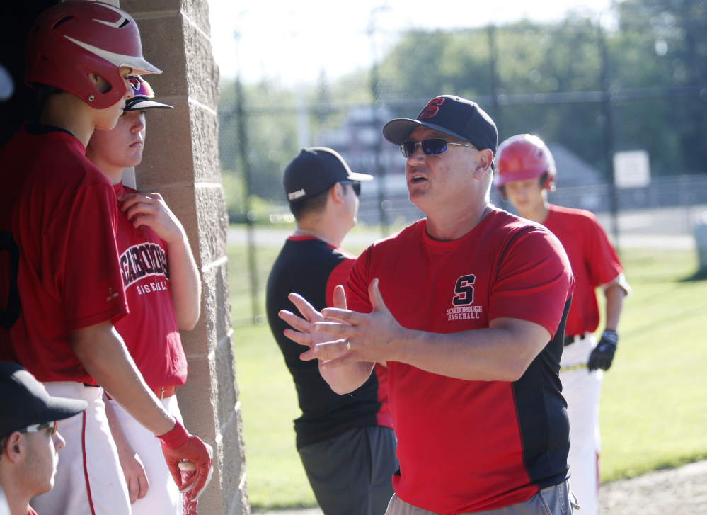 Scarborough Coach Mike D'Andrea talks to his players between innings on Wednesday. D'Andrea says the new league gives players more flexibility to attend weekend tournaments.