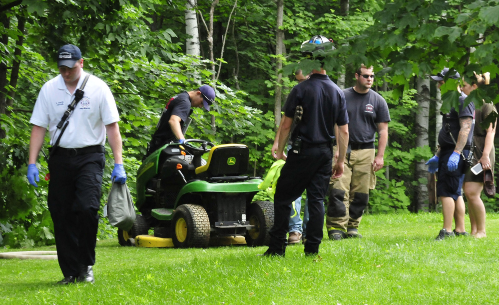 Waterville firefighters helped pull an injured man from a wooded area Wednesday after the lawn mower he was riding toppled down an embankment in Waterville.