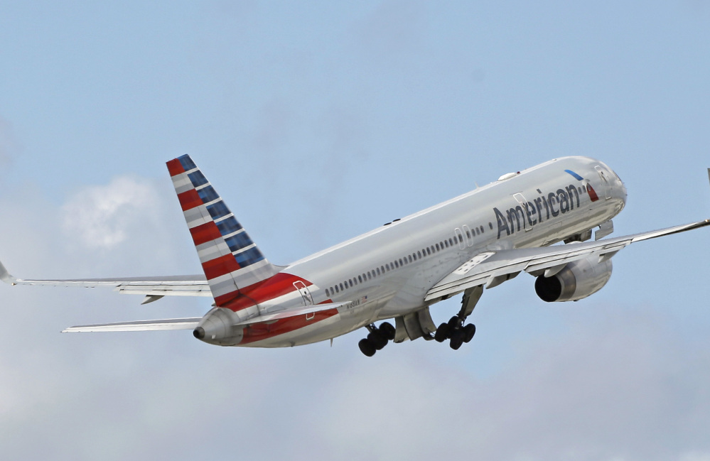 American Airlines passenger jet takes off from Miami International Airport in Miami on June 3. American said in a regulatory filing Thursday that Qatar Airlines' bid to buy shares in the American carrier was unsolicited, but that there have been conversations between the CEOs of both airlines.