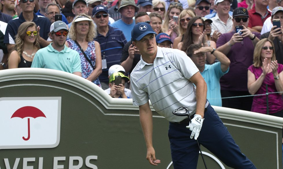 Jordan Spieth watches his drive from the first tee Thursday at the Travelers Championship. Spieth shot an opening-round 63 and will carry a one-shot lead into the second round Friday.