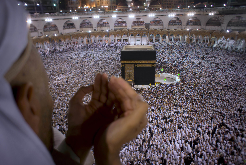 A Muslim worshipper prays during the holy month of Ramadan as pilgrims circumambulate around the Kaaba, the cubic building at the Grand Mosque, in Mecca, Saudi Arabia.