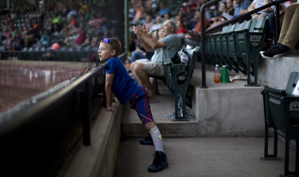 The fans can get up close and personal at historic Goodall Park in Sanford, and Matthew Knous, an 8-year-old from Pittsburgh who was born in Maine, took advantage with his face pressed against the netting.