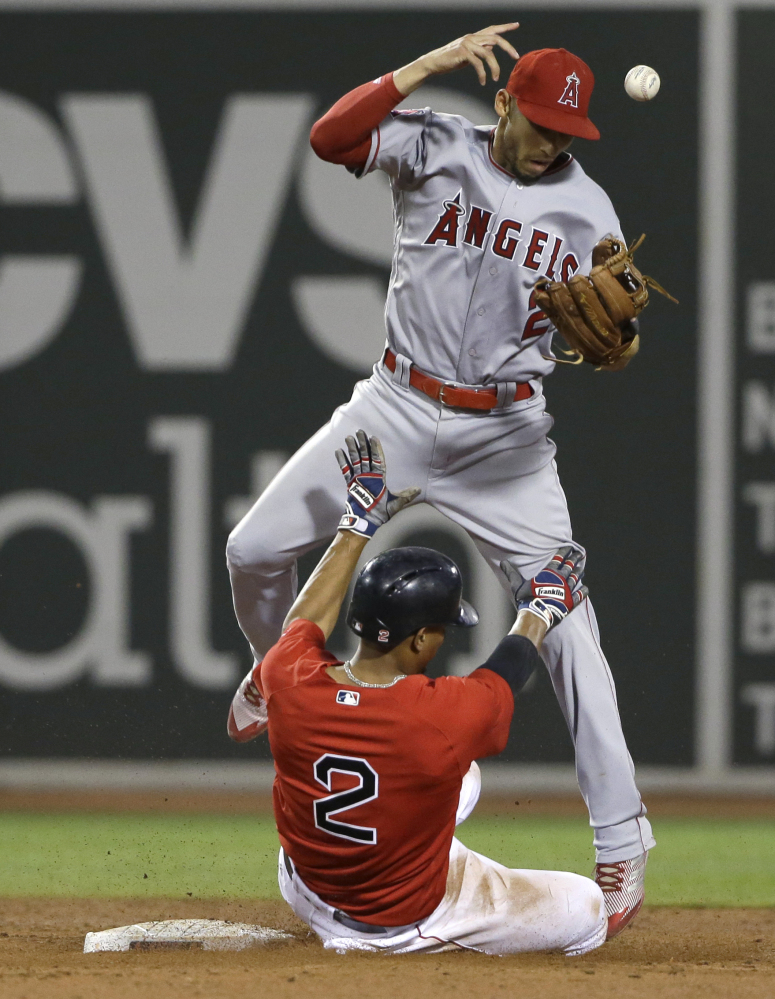 Xander Bogaerts of the Boston Red Sox takes out shortstop Andrelton Simmons of the Los Angeles Angels in an attempt to break up a double play Friday night at Fenway Park. Umpires ruled that Bogaerts interfered with Simmons.