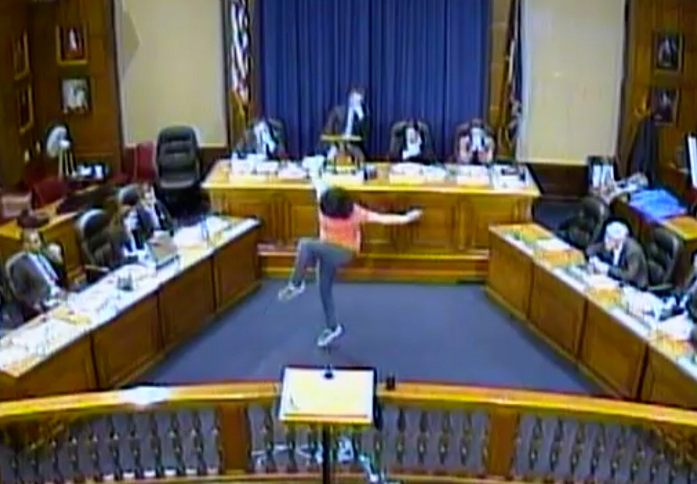 Sara Juli performs her unusual interpretive dance to open a meeting of the Portland City Council in March.
