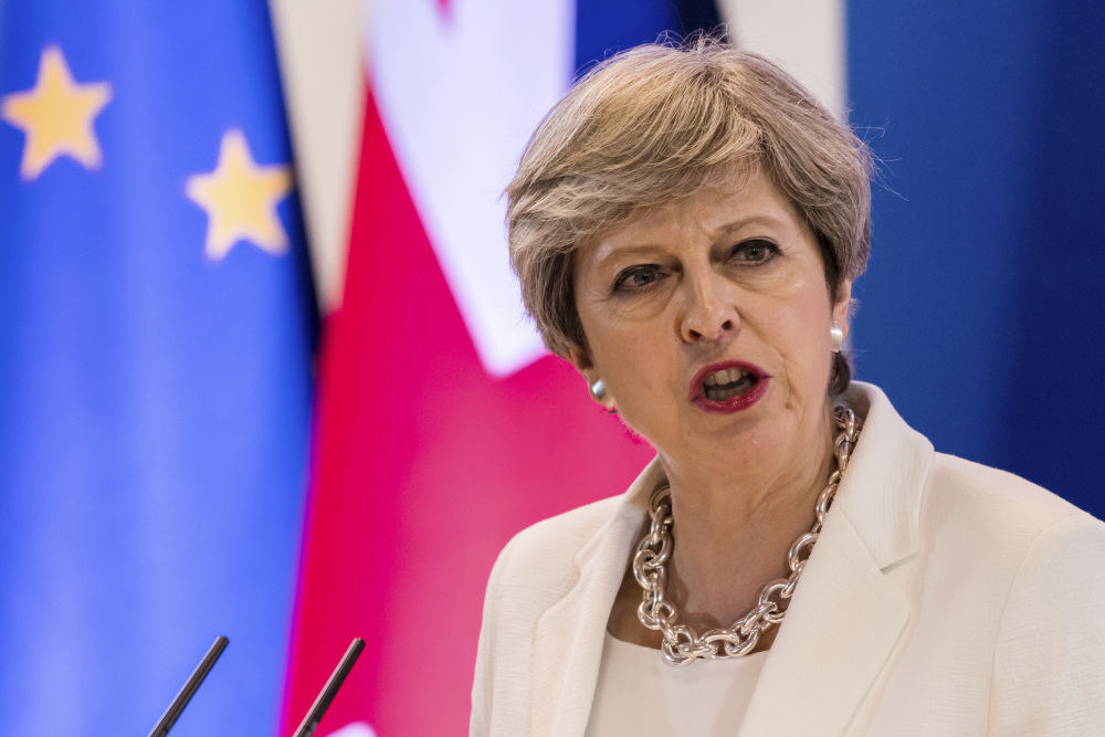British Prime Minister Theresa May offers her post-Brexit plan for citizens' rights at an EU summit in Brussels on Friday. Many said it missed the mark.