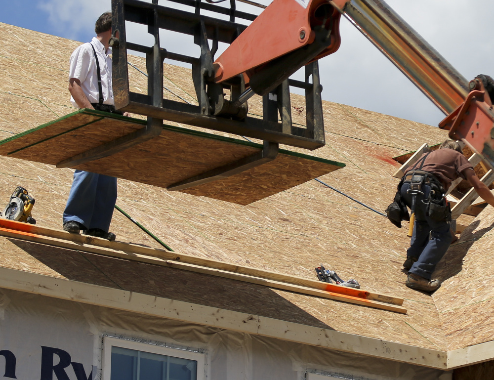 Builders this month work on a home under construction at a project in Jackson Township, Butler County, Pa. The Commerce Department reported Friday that new home sales in the U.S. had climbed 2.9 percent in May.
