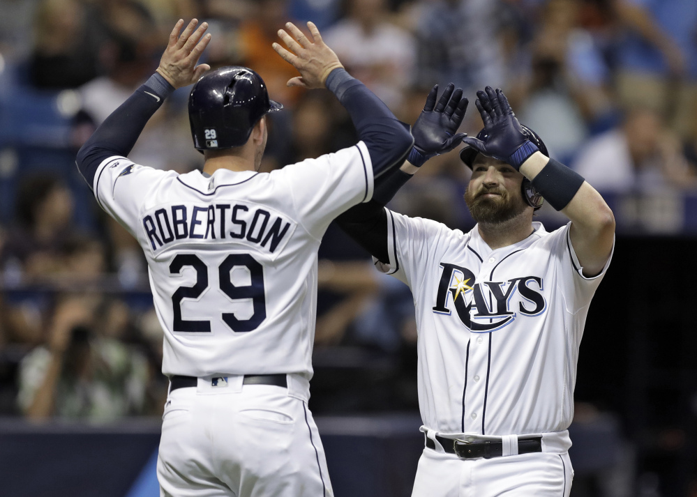 Derek Norris of the Tampa Bay Rays high-fives Daniel Robertson after hitting a two-run homer off Baltimore Orioles starting pitcher Ubaldo Jimenez during the third inning of Friday's game.