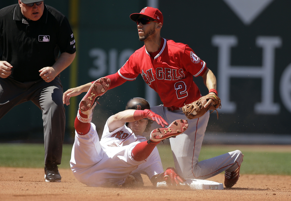 Andrew Benintendi is tagged out by Angels shortstop Andrelton Simmons as he tries to stretch a single into a double in the fourth inning Sunday.