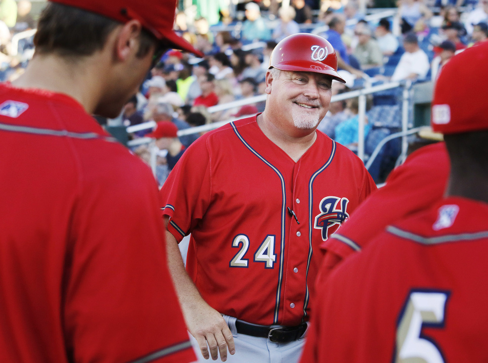 Harrisburg Senators Manager Matt LeCroy speaks to players during Saturday's game against the Portland Sea Dogs at Hadlock Field. LeCroy is in his second stint as Harrisburg manager after serving as bullpen coach for the Washington Nationals for two seasons.