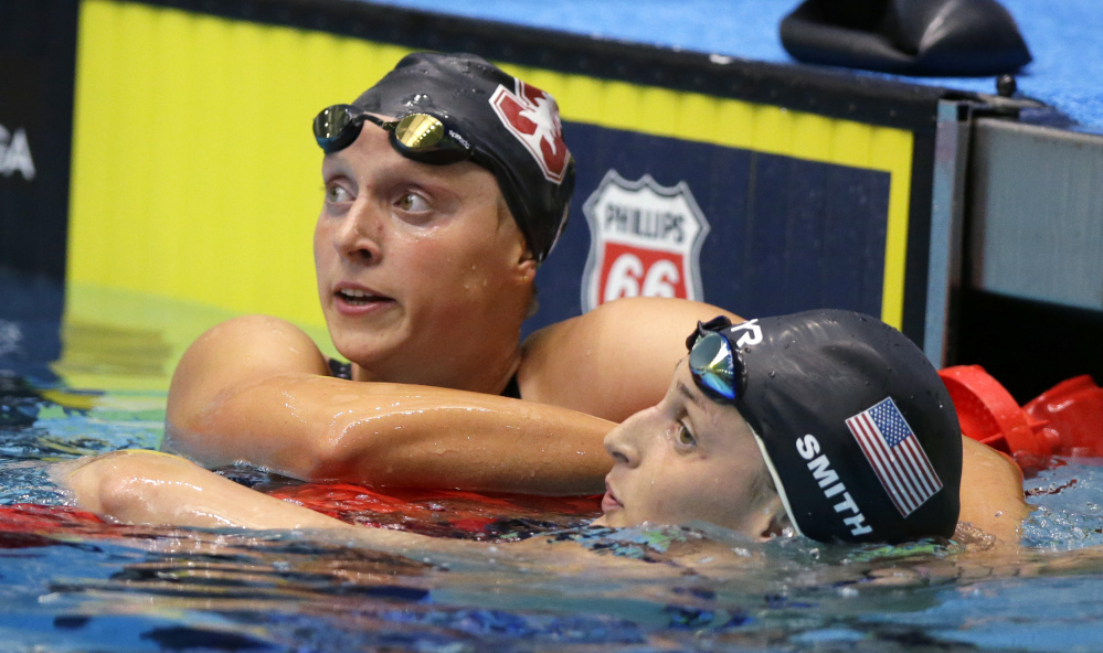 Katie Ledecky, left, celebrates with Leah Smith after winning the women's 800-meter freestyle Tuesday night at the U.S. swimming championships in Indianapolis. Smith took second.