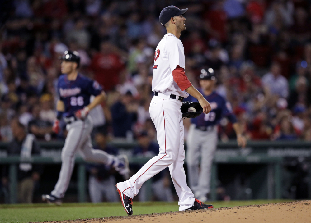 Red Sox starting pitcher Rick Porcello walks back to the mound as Minnesota's Max Kepler rounds the bases on his two-run home run in the sixth inning Wednesday night at Fenway Park.