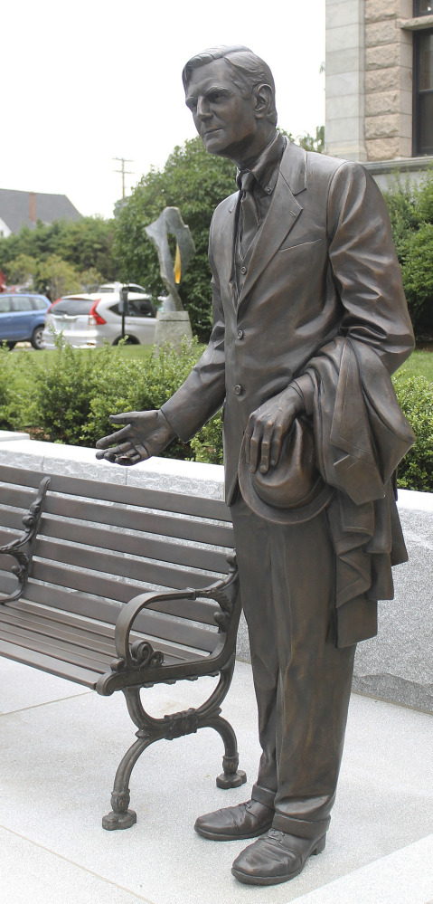 A sculpture of former New Hampshire Gov. John Winant invites passers-by to join him on a bench in Concord, N.H.