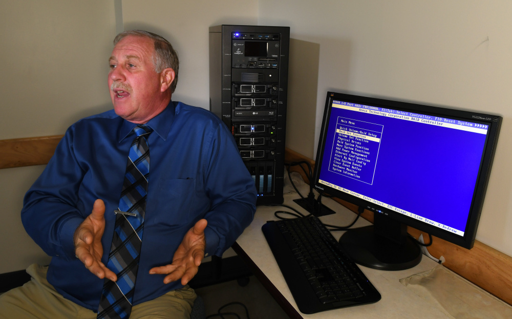 University of Maine at Augusta cybersecurity program director Henry Felch diplays the Forensic Recovery of Evidence Device in the new cybersecurity lab.