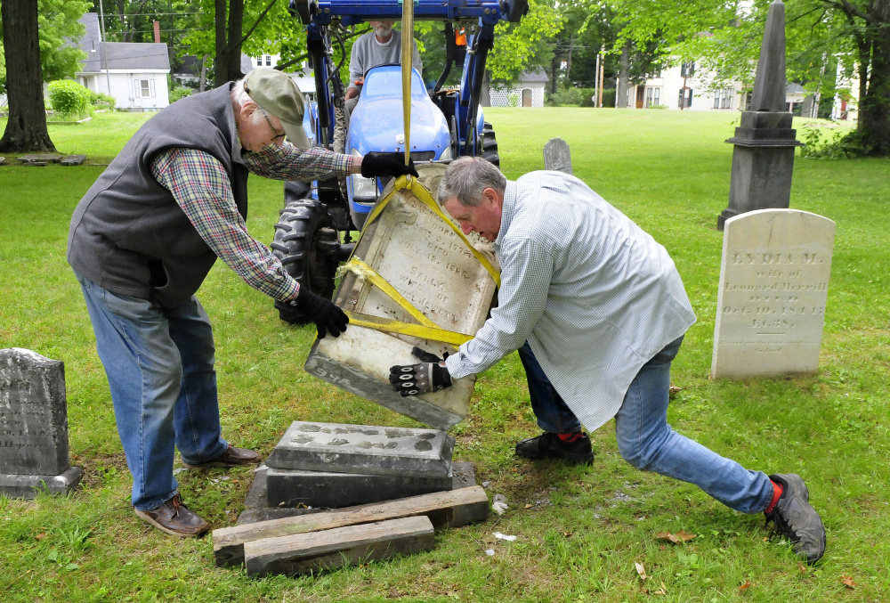 The headstone of Samuel and Sally Jewett is re-erected Tuesday at their grave in the churchyard at the former site of St. Anne's Church in Gardiner.