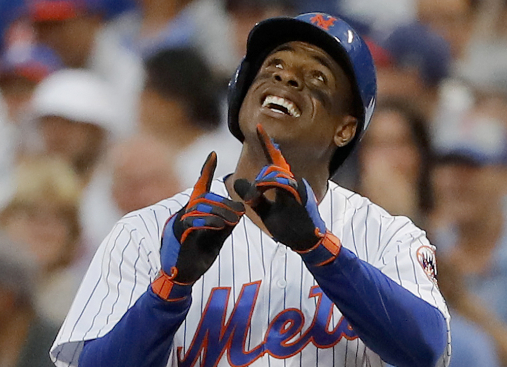 Curtis Granderson of the New York Mets reacts Friday night after driving in a run on an infield single in the second inning of a 2-1 victory against the visiting Philadelphia Phillies.