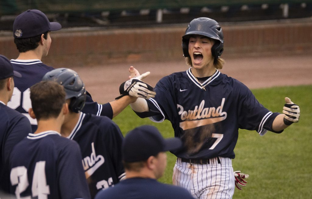 Portland's Cam King celebrates after scoring on Dom Tocci's  three-run triple during the 5th inning.