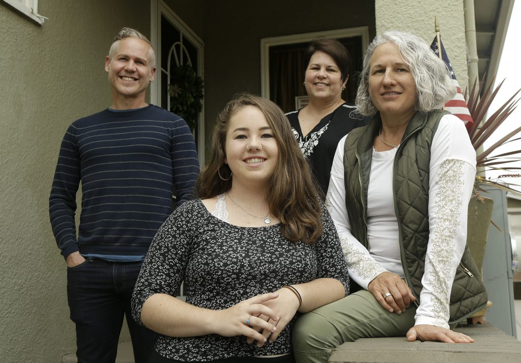 Madison Bonner-Bianchi, center, poses for photos with her parents Mark Shumway, Kimberli Bonner and Victoria Bianchi in Oakland, Calif., on June 8.