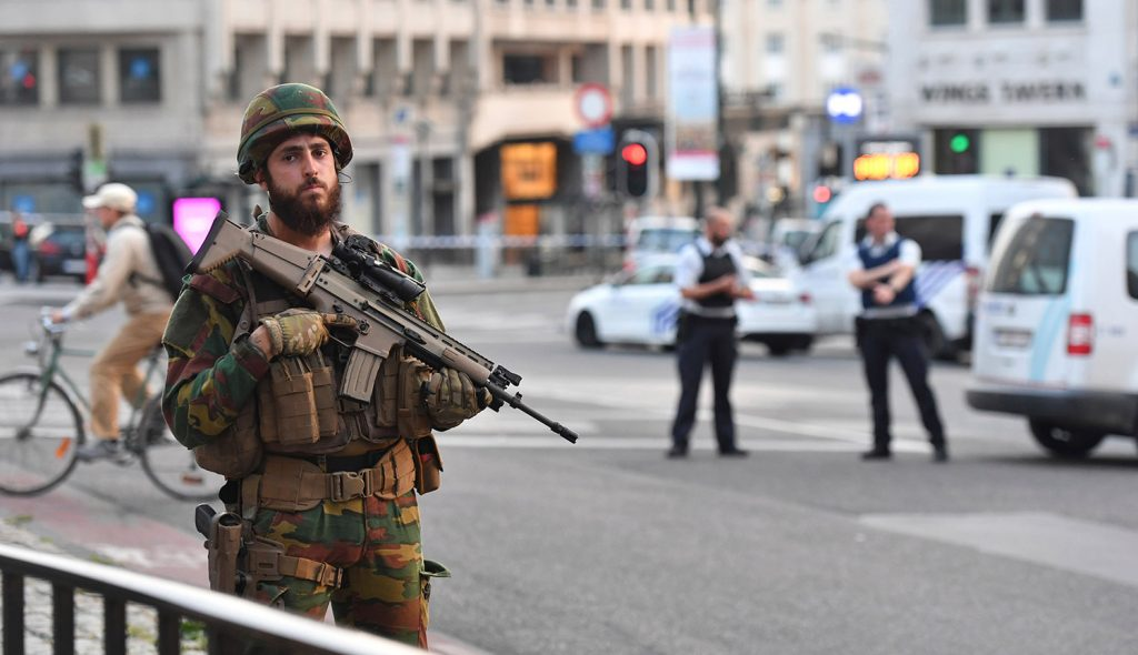 A Belgian Army soldier stands outside Central Station after a small explosion in Brussels on Tuesday.