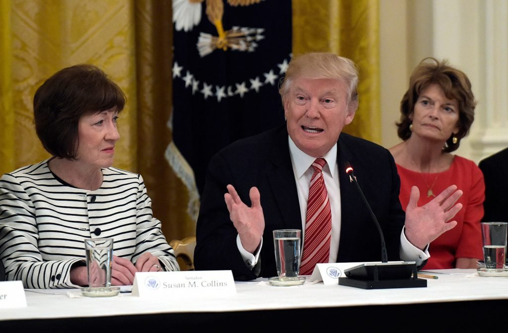 President Trump speaks as he meets with Republican senators on health care at the White House in June. Sen. Susan Collins, R-Maine, left, and Sen. Lisa Murkowski, R-Alaska, right, listen. Collins and Murkowski both oppose the health care bill proposed by Senate Republican leaders.