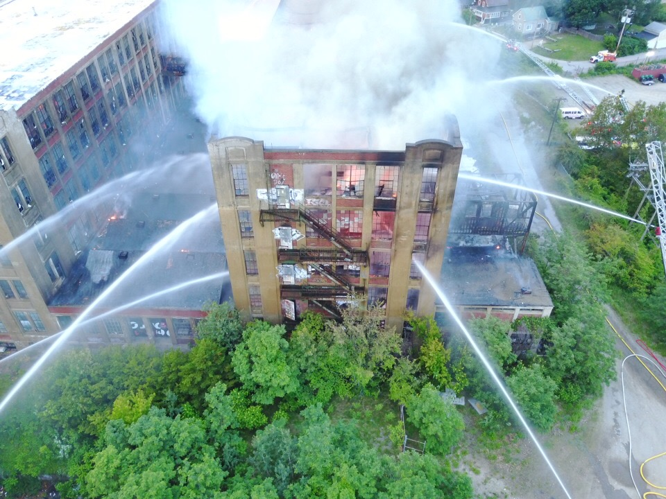 Investigation of mill fire delayed by smoldering debris