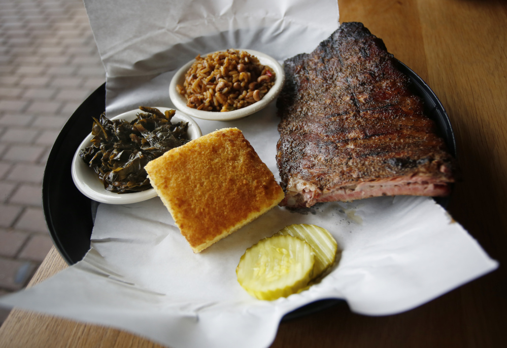 A half-rack of ribs with collards, cornbread, rice and beans at Elsmere in South Portland.