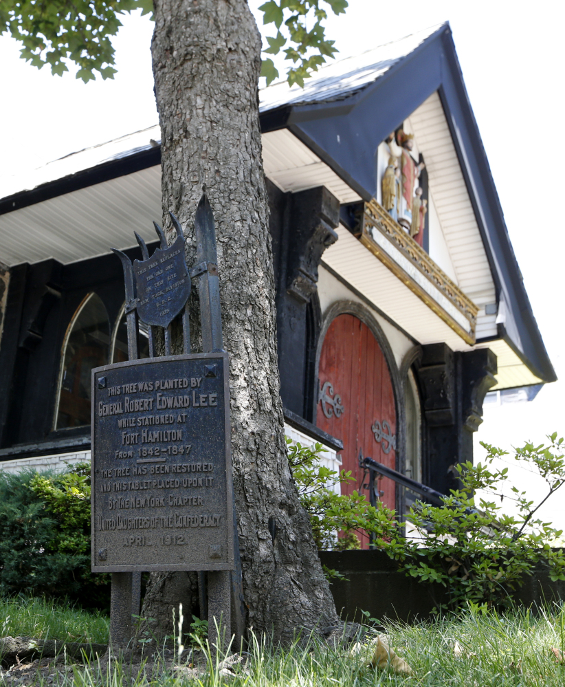 A plaque marks a maple tree planted by Robert E. Lee on the grounds of St. John's Episcopal Church in Brooklyn, who was stationed at nearby Fort Hamilton from 1842-1847.