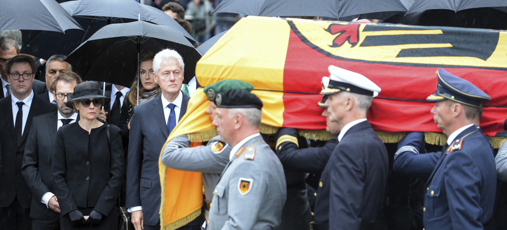 Soldiers carry the coffin of former German chancellor Helmut Kohl in Speyer, Germany, on Saturday. Watching at the side is Kohl's widow Maike Kohl-Richter, left, and former President Bill Clinton. Kohl died June 16 at 87.