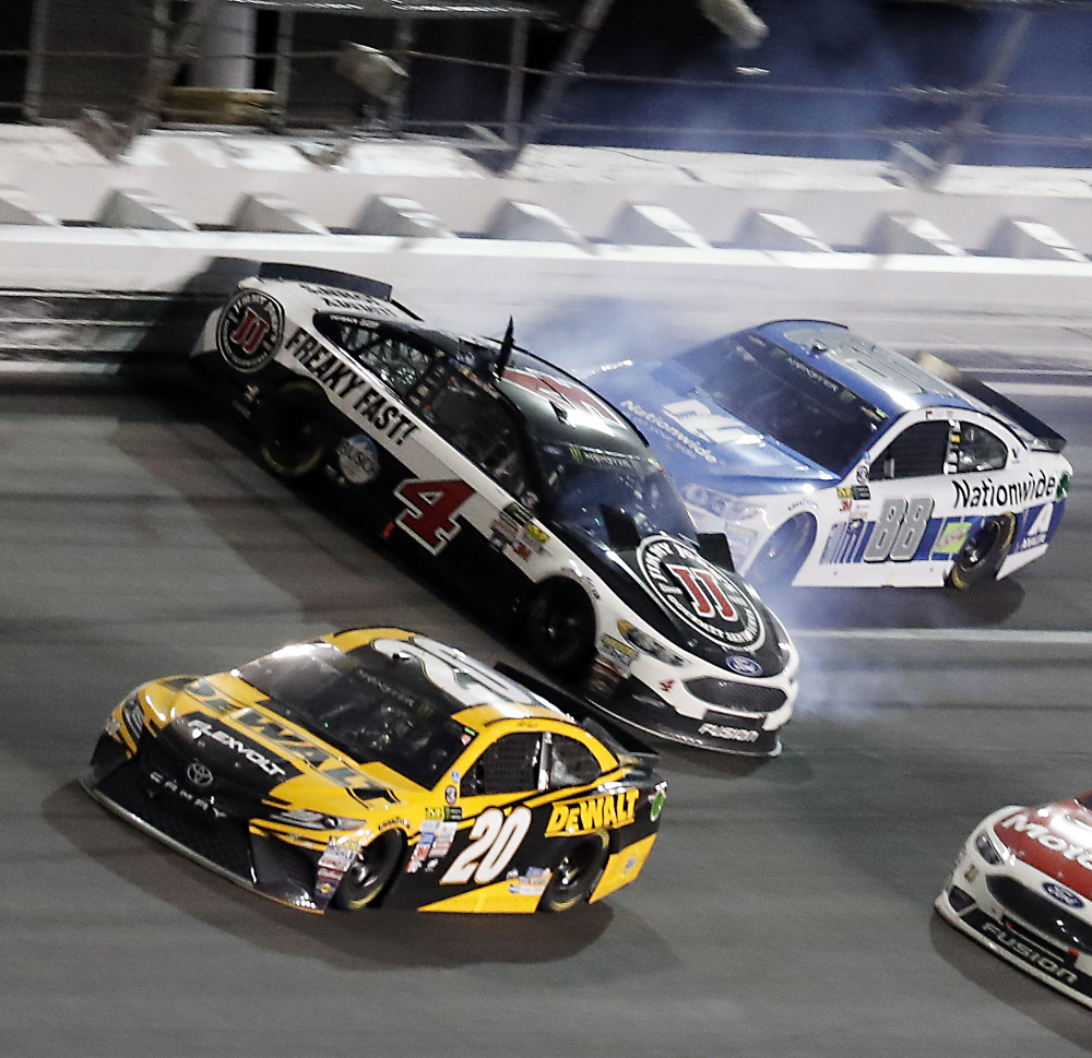 Kevin Harvick (4) is hit by Dale Earnhardt Jr. (88) after he cut a tire as Matt Kenseth (20) avoids the crash during the NASCAR Cup auto race at Daytona International Speedway on Saturday in Daytona Beach, Fla.