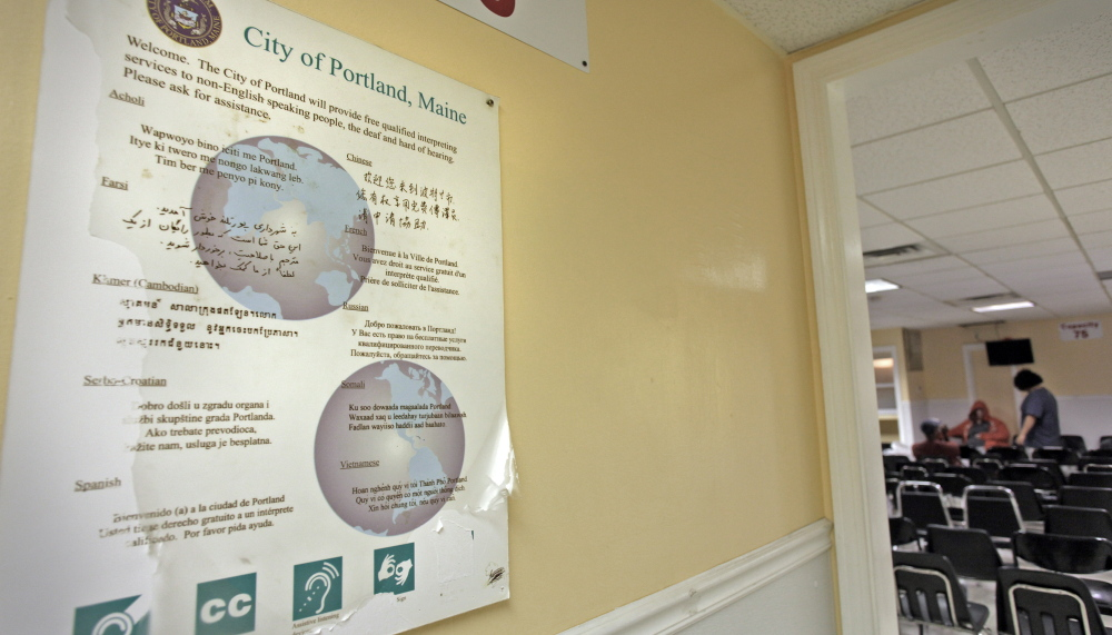 A multilingual sign posted in the General Assistance office in Portland offers staff assistance to non-English speakers in 2014. At the time, a surge of asylum seekers from Central African countries was putting a strain on municipal aid programs.