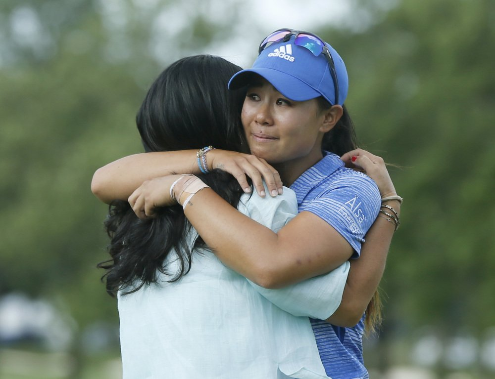 Danielle Kang, right, is hugged by her mom, Grace Lee, after Kang won the Women's PGA Championship on Sunday at Olympia Fields Country Club in Olympia Fields, Ill.