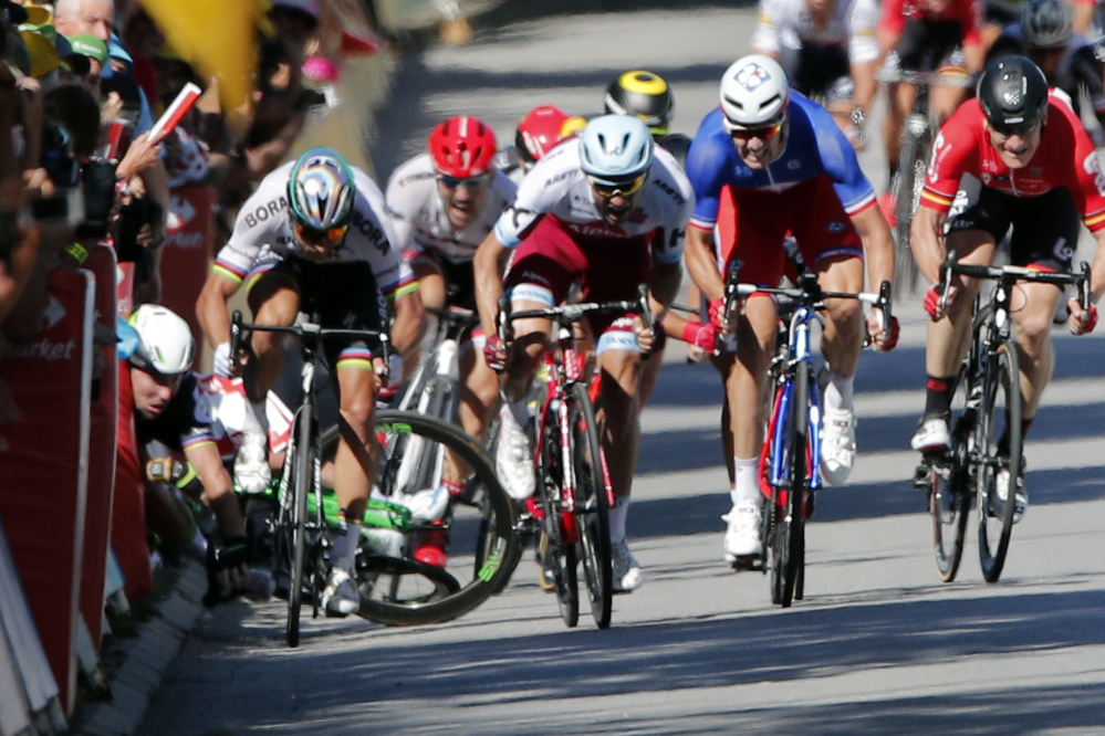 Britain's Mark Cavendish crashes during the sprint of the fourth stage of the Tour de France cycling race over 207.5 kilometers (129 miles) with start in Mondorf-les-Bains, Luxembourg, and finish in Vittel, France, , Tuesday, July 4, 2017. (AP Photo/Christophe Ena)
