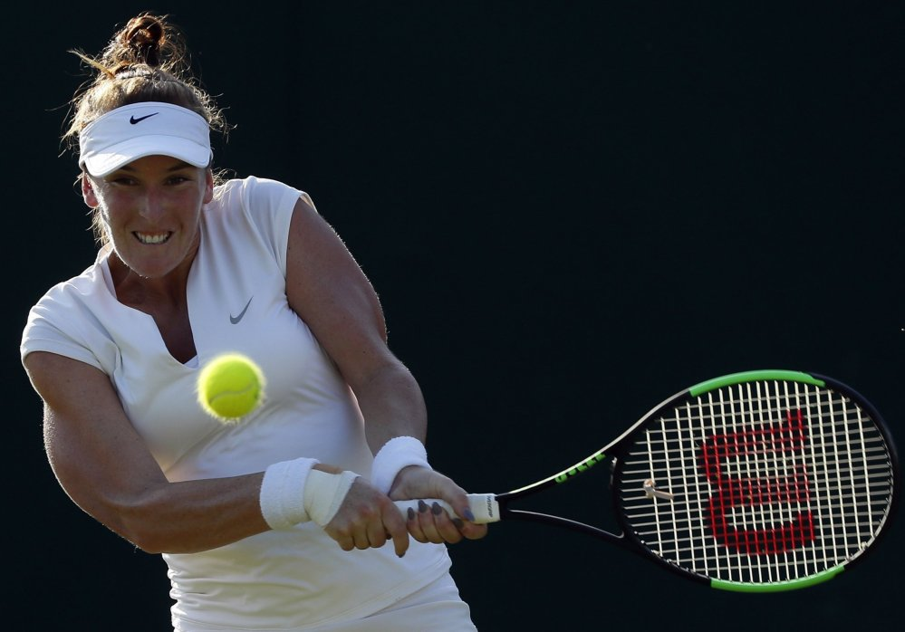 Madison Brengle of the United States returns against Petra Kvitova during their second-round match Wednesday at the All England Club. Brengle, ranked 95th in the world, pulled a 6-3, 1-6, 6-2 upset of the two-time Wimbledon winner.