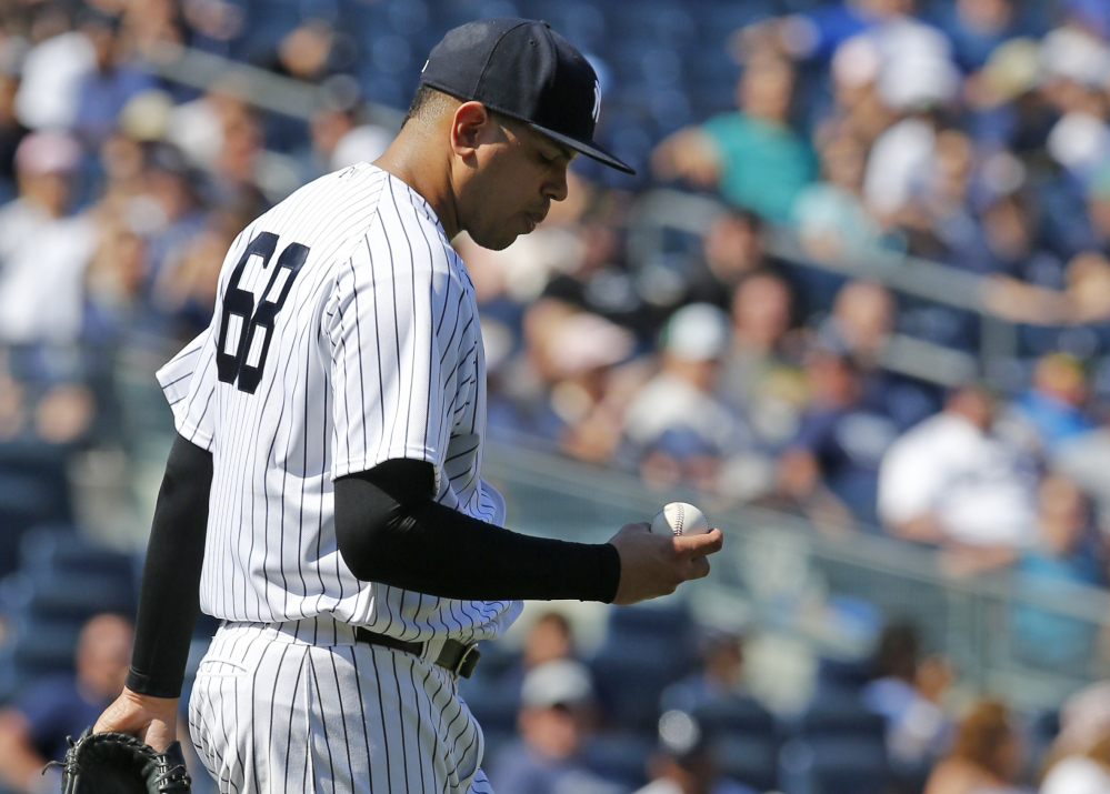Yankees relief pitcher Dellin Betances has his head down after loading the bases in the eighth inning against Toronto on Wednesday. He went on to walk in the go-ahead run in a 7-6 loss.