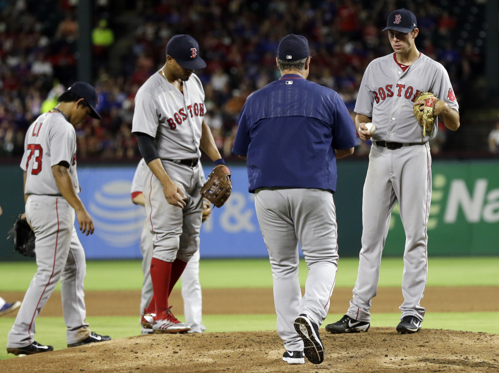 Red Sox manager John Farrell walks up to take the ball from starting pitcher Doug Fister in the fourth inning of Wednesday night's game.