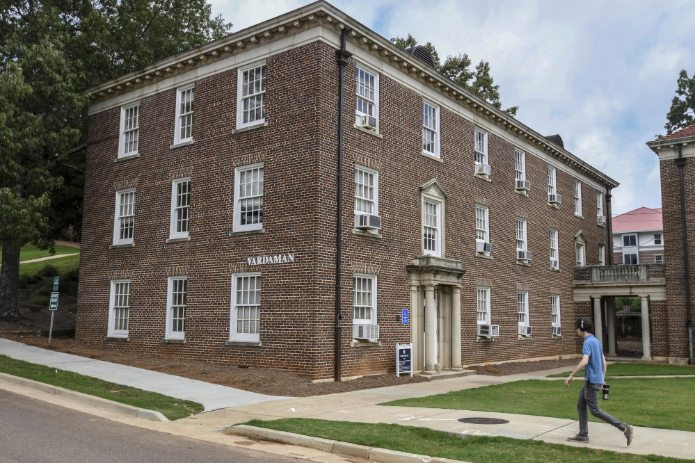 A pedestrian walks past Vardaman Hall at the University of Mississippi in Oxford on Thursday. The school says it will post a sign acknowledging that slaves built some structures on the main campus founded before the Civil War.