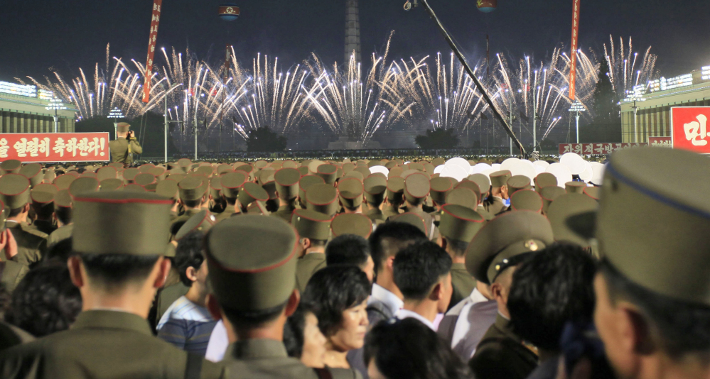 Soldiers and civilians watch fireworks in Kim Il Sung Square in Pyongyang, North Korea, on Thursday, as they celebrate the successful test launch of North Korea's first intercontinental ballistic missile two days earlier.