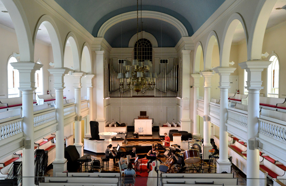 College and postgraduate students rehearse Thursday for the Atlantic Music Festival in Lorimer Chapel at Colby College.