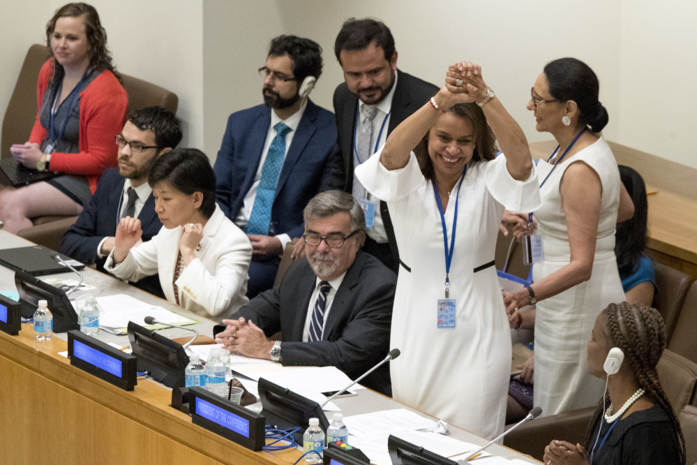 Costa Rican Ambassador Elayne Whyte Gomez, President of the United Nations Conference to Negotiate a Legally Binding Instrument to Prohibit Nuclear Weapons, reacts after a vote by the conference to ban nuclear weapons.